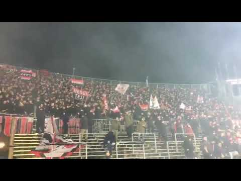 AC Milan fans chant together last night when Milan play against Atalanta